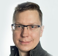 A white male with short hair and glasses